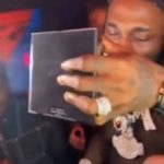 (VIDEO) Fans react as Burna boy drinks champenge from his Grammy award plaque